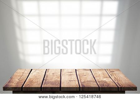 Wooden Floor against wall covered with windows