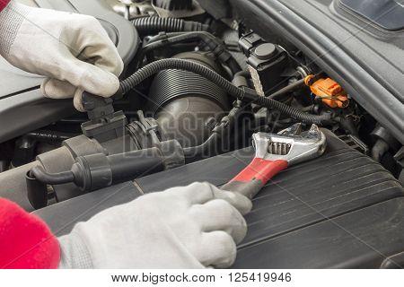 Mechanician Performing Maintenance On A Car Engine