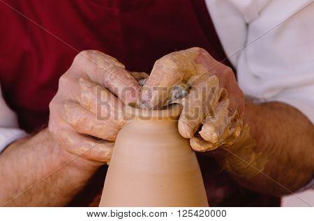 Detail On Potter Hands Making A Vase