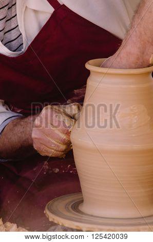 Detail On Potter Hands Modeling A Vase