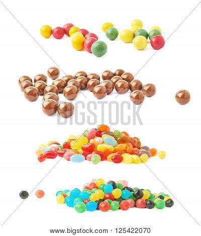 Pile of multiple colorful jelly bean candy sweets isolated over the white background, set of four different kinds of candies