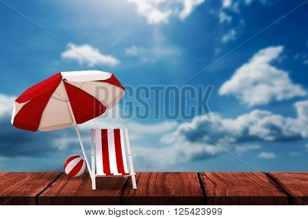Image of sun lounger and sunshade against blue sky