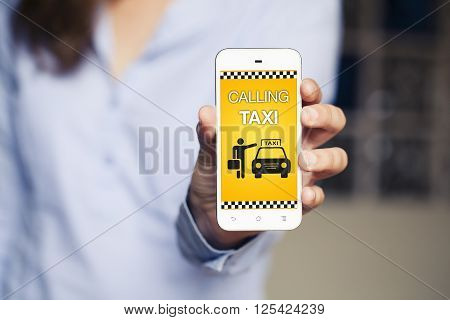 Booking taxi app in a mobile phone hold by woman hand.