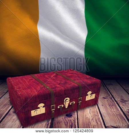 Wooden suitcase against ivory coast national flag