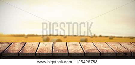 Wooden desk against hay bales in the countryside