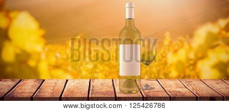 White wine against greenness field of grapevine
