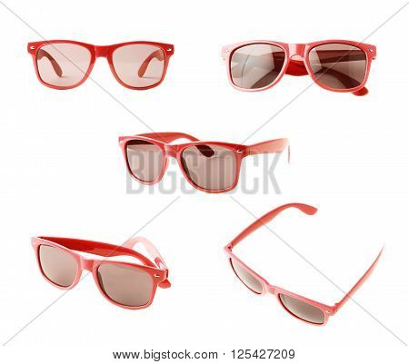 Dark sunglasses in a red plastic frame isolated over the white background, set of five different foreshortenings