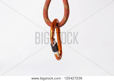 Carbine and rope isolated on a white backgroun. Climbing equipment