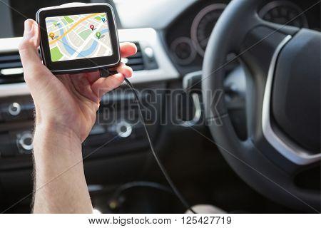 Map app against man using satellite navigation system