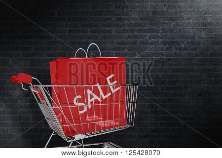 Trolley with sale shopping bag against a dark wall