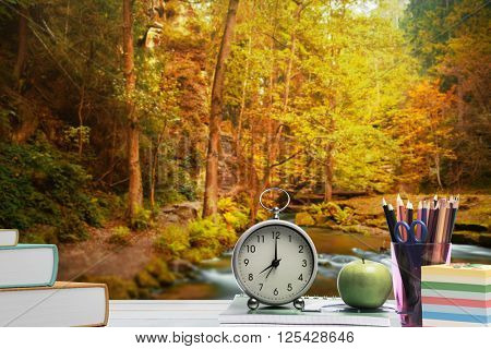 desk against autumn scene