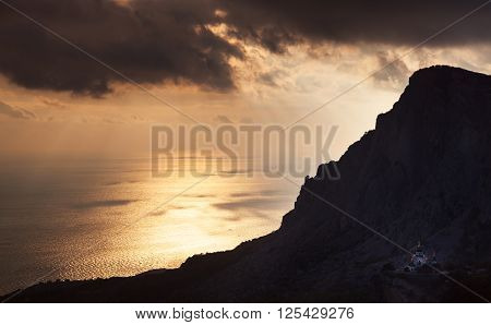Small church under a mountain at sunset. Russia Crimea Foros.