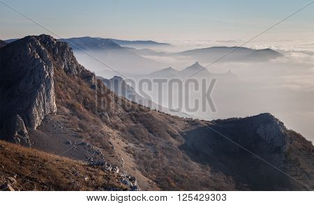 Landscape. The mountains at dawn in the mist