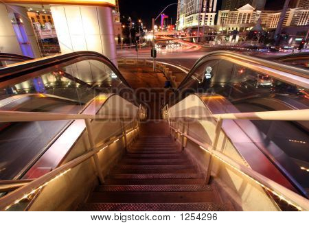 Escalator And Staircase Down With Blurred Traffic And Lights