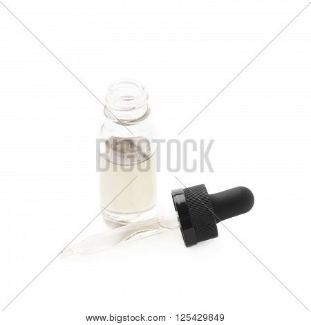 Small medical bottle with a pipette, filled with transparent liquid isolated over the white background