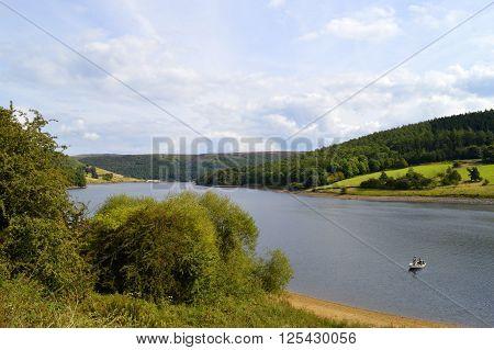 A boat on Ladybower reservoir in Derbyshire England UK