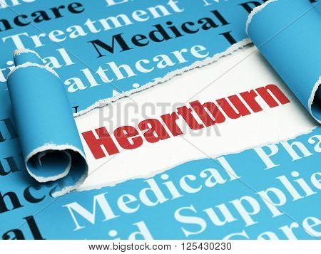 Healthcare concept: red text Heartburn under the piece of  torn paper