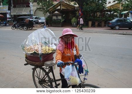 Woman With Bicycle Who Sold Sweets