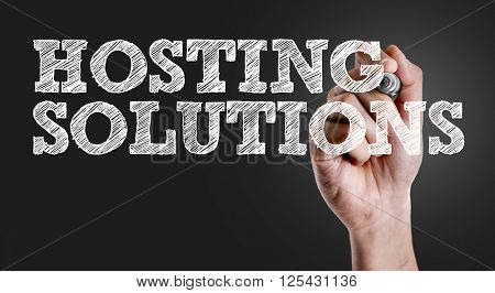 Hand writing the text: Hosting Solutions