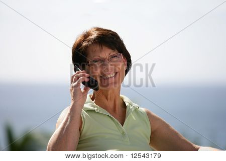 Portrait of a smiling senior woman phoning