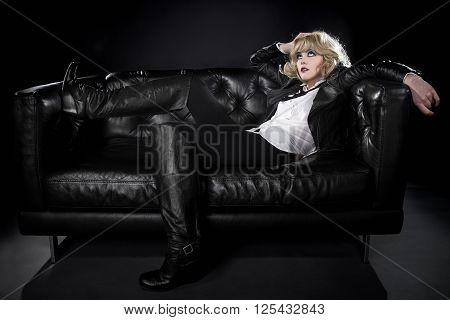 Female wearing black punk rock style leather expressing unique fashion style