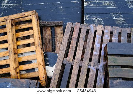 Bunch of old wet colored wooden pallets