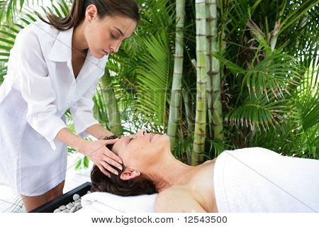 Portrait of a senior woman being massaged