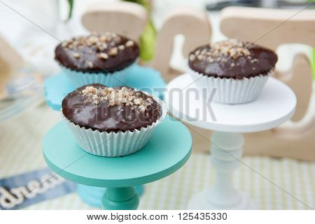 three spongecake or muffin with chocolate sauce
