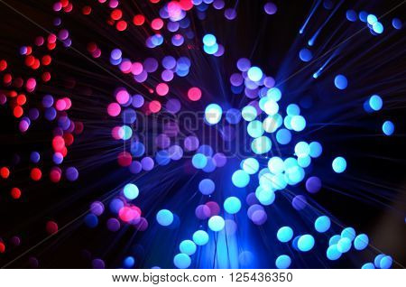 Blurred abstract pink and blue bokeh lights. Christmas holiday defocused background. Backdrop for your design