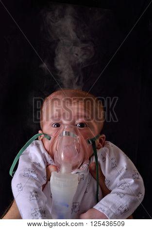 Baby using medical respiratory inhalator mask vapor seam treatment for flu