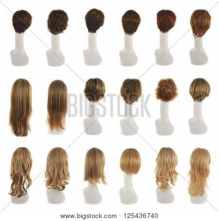 Hair wig over the white plastic mannequin head isolated over the white background, set of multiple different wigs in the back foreshortening