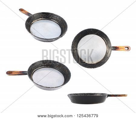 Old black burnt pan with a handle isolated over the white background, set of four foreshortenings