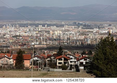 SOFIA, BULGARIA - MARCH 7, 2016: Cityscape of the Bulgarian capital viewed from the Vitosha mount. Sofia is the 15th largest city in the European Union with population of more than 1.3 million people