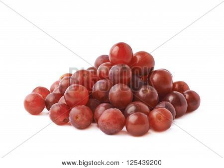 Pile of dark red grapes isolated over the white background