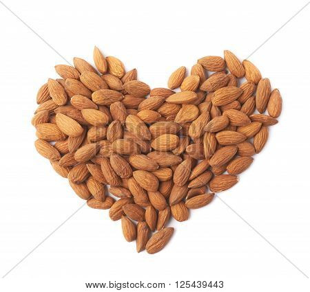 Heart shape made of multiple almond seeds isolated over the white background