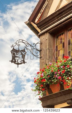 A typical shopsign in the city  in Colmar. Alsace. France.