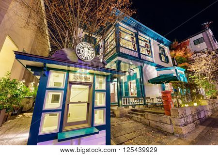 KOBE, JAPAN - DECEMBER 12, 2015: Starbucks coffee shop in the Kitano District of Kobe. The repuropsed home was originally erected in 1907 for foreign residents and is a designated cultural property.
