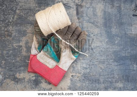Roll Of String And Pair Of Muddy Gardening Gloves