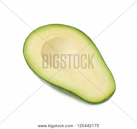 Half of ripe avacado fruit without the pit, composition isolated over the white background