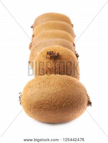Line of six kiwi fruits or chinese gooseberry kiwi isolated over the white background