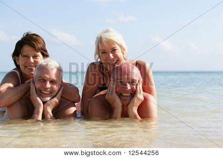 Portrait of a group of smiling seniors bathing in the sea