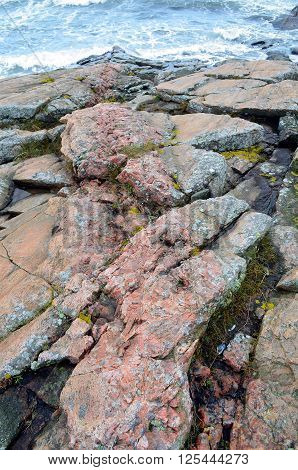 red massive rocks at the coast of south sweden