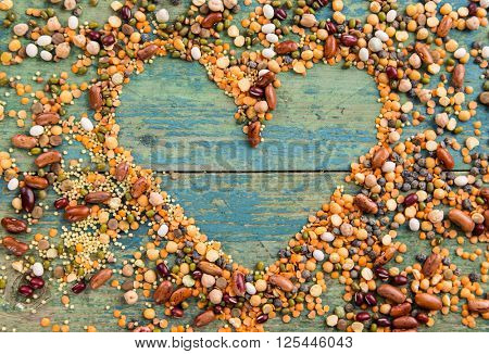 Raw legume heart on old rustic wooden table, close-up.