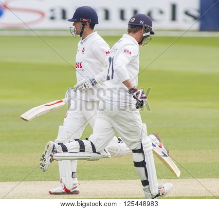 CHELMSFORD, ENGLAND - APRIL 11 2016: Alastair Cook and Tom Westley of Essex run a single during the Specsavers County Championship match between Essex and Gloucestershire at the County Ground
