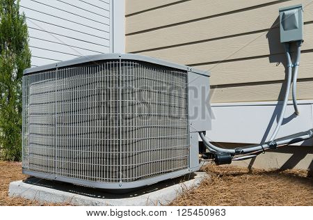 A/C unit connected to the residential house
