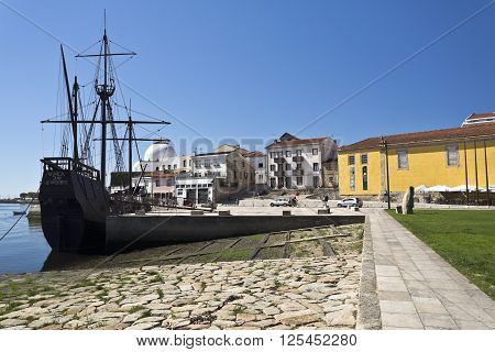 VILA DO CONDE, PORTUGAL - September 20, 2015: Replica of a caravel and the shipyard on September 20, 2015 in Vila do Conde, Portugal