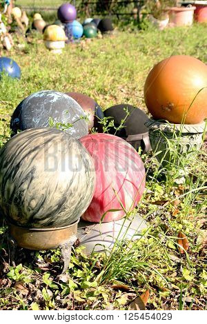 Old Bowling Balls (old bowling balls in the sunlight)