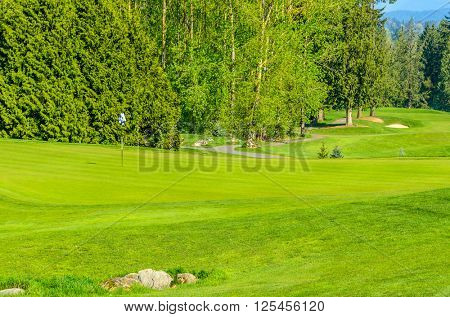 Gorgeous green at the beautiful golf course.