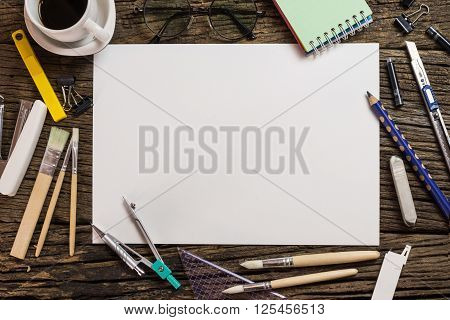 Top View Of Blank Paper And School Supplies On The Dark Wood