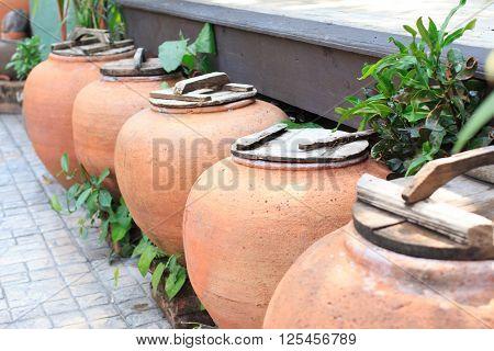aged water earthen jar in the garden